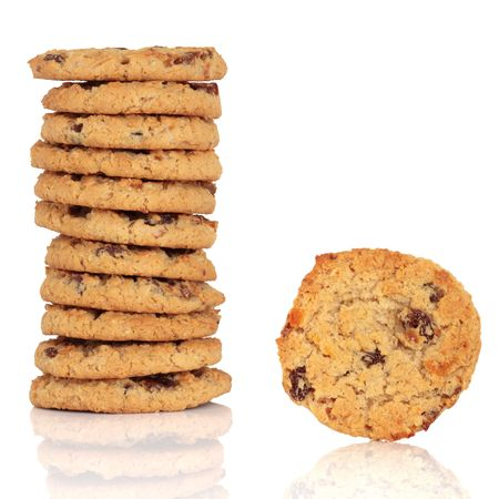 Flapjack chocolate chip cookie stack with one alone, isolated over white background with reflection.