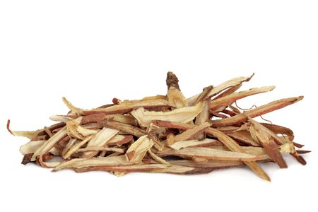 Liquorice root, used in chinese herbal medicine, isolated over white background. Gan cao, Radix glycyrrhiza.
