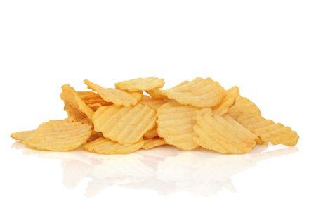 Potato crisps isolated over white background with reflection. Stock Photo