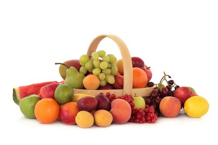 Fruit collection inside and surrounding a rustic wooden basket, isolated over white background. photo
