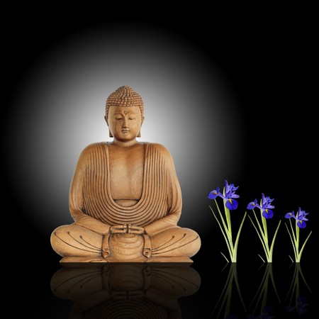 Smiling buddha with eyes closed in prayer and blue iris flowers against a black background with white central glow and reflection.