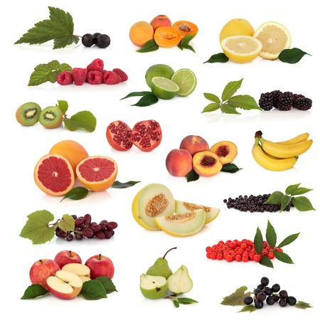 Large fruit collection high in antioxidants, isolated over white background.