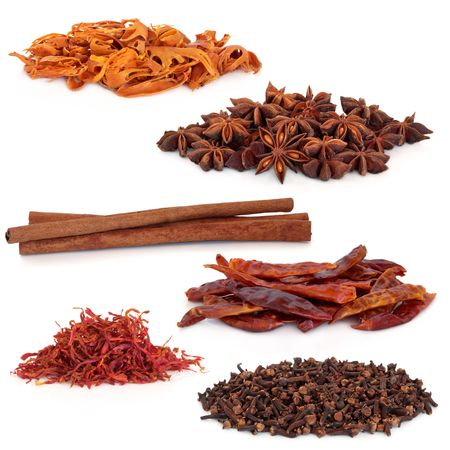 mace: Spices selection of cloves, saffron, chillies, cinnamon, star anise and mace, isolated over white background.