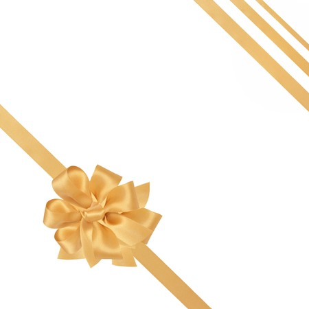 Gold satin ribbons with bow isolated over white background. Stock Photo - 7156852
