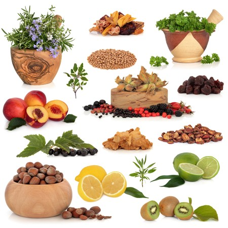 Healthy super food collection of fresh and dried fruit, herbs, pulses and nuts, very high in antioxidants and vitamins, isolated over white background. photo