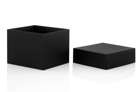 Black gift box open with lid to one side, isolated over white background with reflection. Stock Photo - 7213666