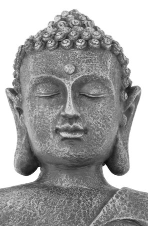 Buddha face with eyes closed in prayer, isolated over white background. Mass produced statue. photo