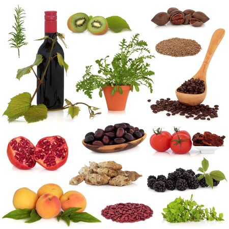 antioxidant: Super food collection, very high in antioxidants and vitamins, isolated over white background. Stock Photo