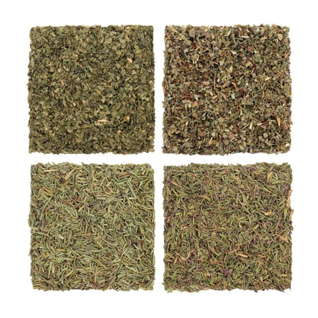 Parsley, sage rosemary and thyme dried herbs isolated over white background. In clockwise order from top left. Stock Photo - 7252716