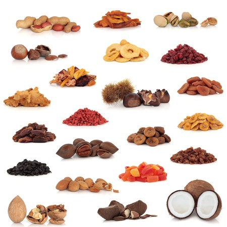 Healthy dried fruit and nut food collection isolated over white background.  Stock Photo