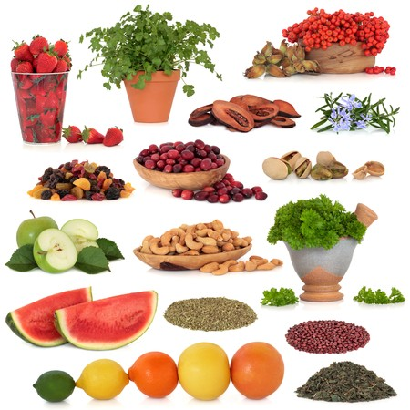 Healthy super food collection of fruit, herbs, pulses and nuts, very high in antioxidants and vitamins, isolated over white background. Stock Photo - 7252722