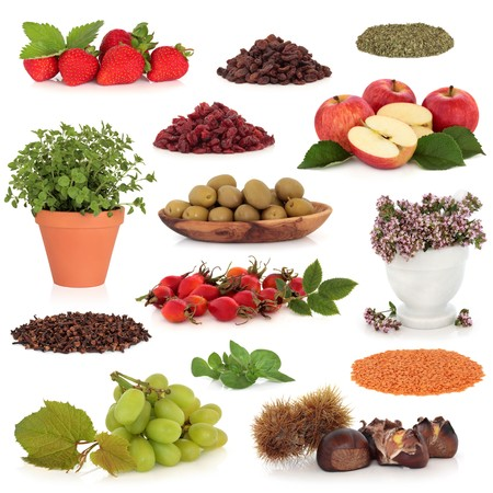 Healthy food collection of fruit, nuts, herbs and pulses, very high in antioxidants and vitamins, isolated over white background. photo