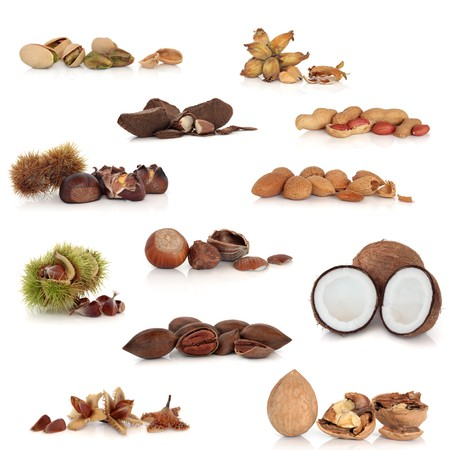 Large mixed nut food collection, isolated over white background. photo