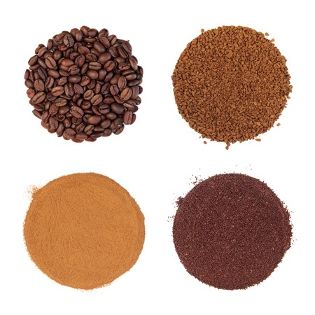 scattered on white background: Coffee beans, instant, espresso with cream, and ground, top left to bottom right in circular shapes with scattered granules, isolated over white background. Stock Photo
