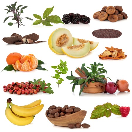 Super food collection of fruit, nuts, herbs and spices, very high in antioxidants and vitamins, isolated over white background. Stock Photo - 7345371