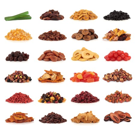 Large collection of dried and candied fruit for snacks and culinary use, isolated over white background. Stock Photo