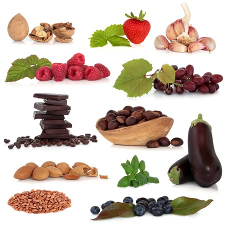 Healthy food collection very high in antioxidants and vitamins, isolated over white background. photo
