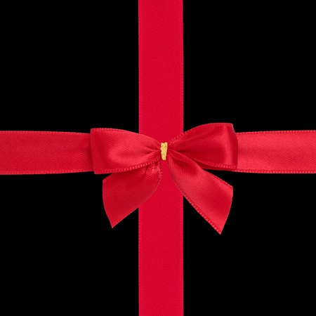 black ribbon bow: Red satin ribbon and bow gift box wrapping  isolated over black background.