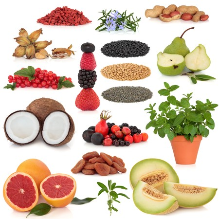 Healthy super food collection of nuts, dried and fresh fruit, herbs and pulses, very high in antioxidants and vitamins, isolated over white background. Stock Photo - 7441663