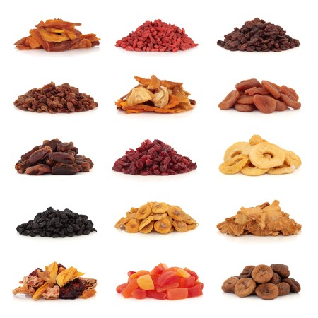 Large collection of dried and candied fruit for snacks and culinary use, isolated over white background. photo