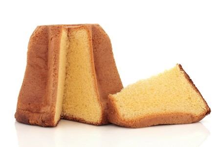 Pandoro italian christmas cake with a slice taken out, isolated over white background.