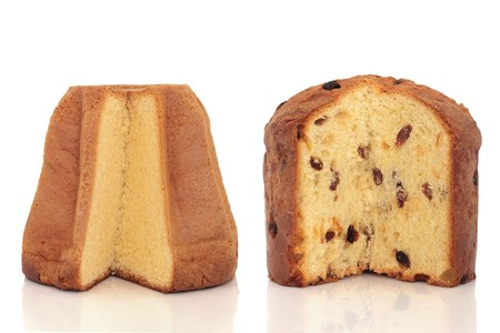 Pandoro and panettone italian christmas cakes with slices taken out to reveal inside, over white background.