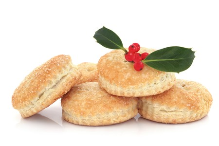 minced pie:  Mince pie stack with holly leaf, isolated over white background. Stock Photo
