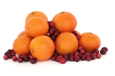 cranberry fruit: Christmas tangerine and cranberry fruit, scattered, isolated over white background.