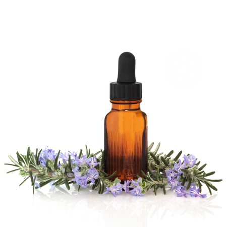 Rosemary herb leaf and flower sprigs with aromatherapy essential oil glass bottle, isolated over white background with reflection. Stock Photo - 8030851