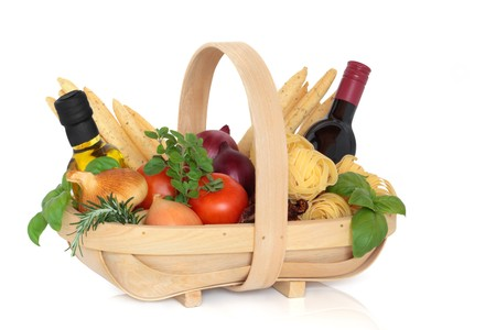 Italian food selection in a rustic wooden basket over white background. photo