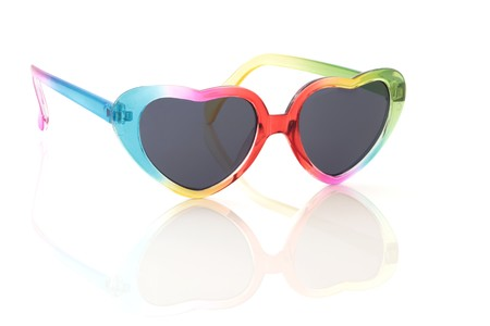 Heart shaped rainbow coloured sunglasses, isolated over white background with reflection. Stock Photo - 8176805