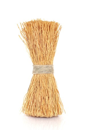 bristle: Wok cleaning natural bristle brush tied  with string, isolated over white background.