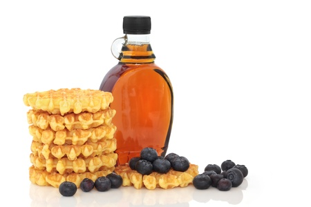 Blueberry fruit with waffles and maple syrup, isolated over white background. photo