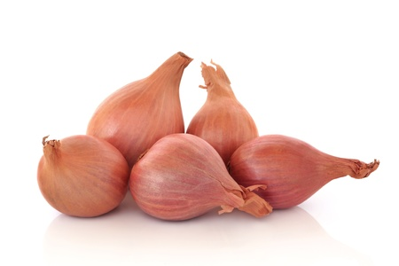 shallot: Shallot onions in a group isolated over white background.