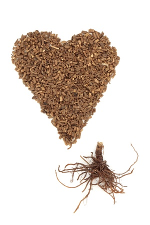 valium: Valerian herb in heart shape with root, over white background. Modern day alternative equivalent is the drug Valium. Stock Photo