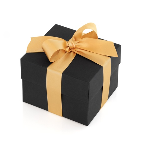 Black gift box with gold satin ribbon bow, over white background. Stock Photo - 9026342