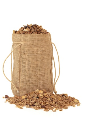 hessian bag: Muesli cereal mixture in a hessian bag and scattered isolated over white background.
