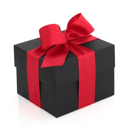 black ribbon bow: Black gift box with red satin ribbon and bow, over white background.