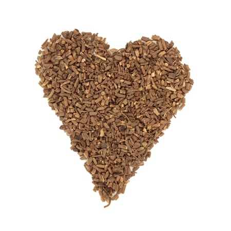 valium: Valerian herb chopped root in heart shape, over white background. Modern day alternative equivalent is the drug Valium.
