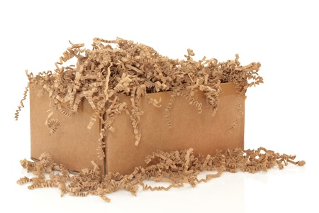 tatty: Cardboard shipping box with recycled brown paper protective filler, isolated over white background.