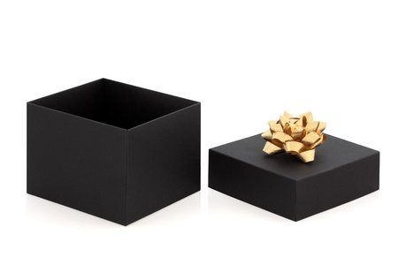 Gift box with lid off and gold decorative rosette ribbon, isolated over white background. photo