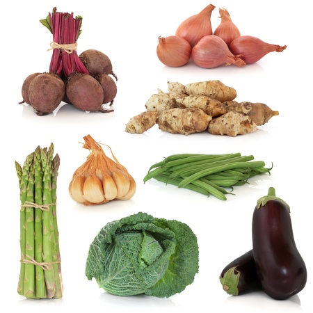 Vegetable sampler of asparagus, aubergine, savoy cabbage, bean, beetroot, shallot, garlic and jerusalem artichoke, isolated over white background. photo