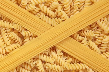 Fusilli and spaghetti pasta in abstract design. Stock Photo - 9945445