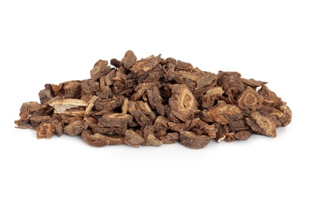 chinese herbal: Notopterygium root used in chinese herbal medicine isolated over white background. Rhizoma et radix notopterygii. Stock Photo