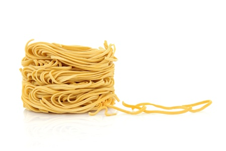 chinese noodle: Egg noodles with noodle strands to the side, isolated over white background Stock Photo