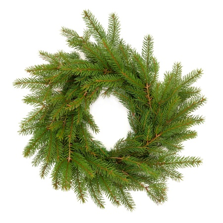 Christmas wreath made of spruce fir pine with no decorations isolated over white background.