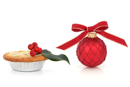 Christmas red bauble decoration, with mince pie and holly berry leaf sprig  isolated over white background. Stock Photo - 10679081