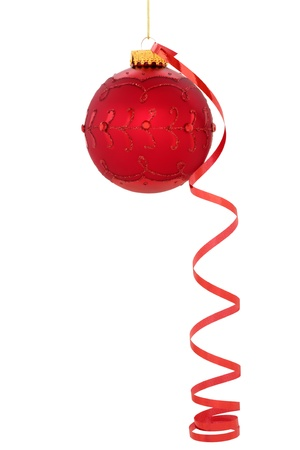 dangling: Christmas red ball decoration with curly ribbon  isolated over white background. Stock Photo
