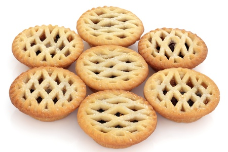 Latticed mince pie group isolated over white background. Selective focus. photo