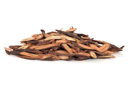 caulis: Fleece flower herb stem used in chinese herbal medicine isolated over white background. Ye Jiao Teng.  Caulis polyoni multiflori.